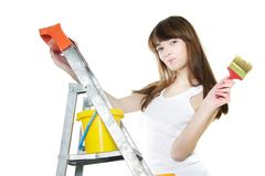 Attractive girl with paintbrush over white Stock Photos