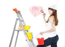 Attractive girl painting over white. Attractive young girl painting over white Stock Image
