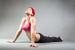 Attractive girl performing exercises. Portrait of attractive girl performing exercises royalty free stock images