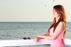 Attractive girl on pier Young woman and sea Stock Photography
