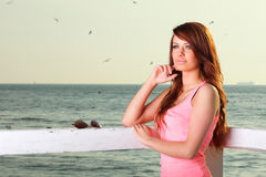 Attractive girl on pier Young woman and sea Royalty Free Stock Photos