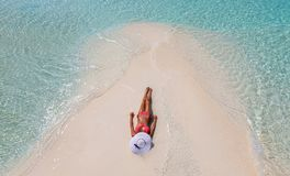 Attractive girl tanning on a sandbank in the Maldives Stock Photos