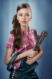 Attractive girl with a pipe wrench Royalty Free Stock Images