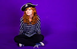 Attractive girl in a pirate costume and hat Stock Image