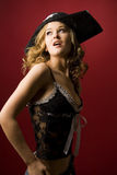 Attractive girl in pirate hat. With skull isolated on red background royalty free stock images