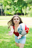 Attractive girl play with ball Royalty Free Stock Photo