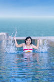 Attractive girl play in swimming pool Royalty Free Stock Photos