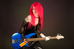Attractive girl playing bass guitar Stock Photography