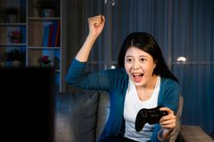 Attractive girl playing television video game Stock Photo