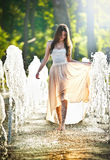 Attractive girl in playing in water fountain Stock Image