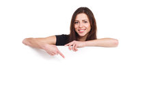 Attractive girl pointing to blank ad Royalty Free Stock Photo