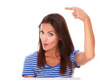 Attractive girl pointing to her right Royalty Free Stock Image