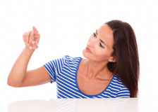 Attractive girl pointing to her right Royalty Free Stock Photography