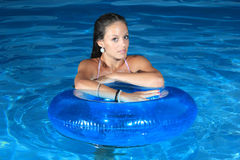 Attractive girl in the pool Royalty Free Stock Photography