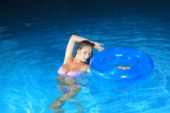 Attractive girl in the pool Stock Photo
