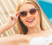 Attractive girl at the pool Royalty Free Stock Photo