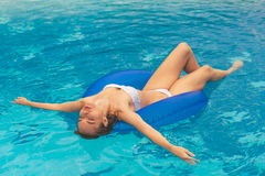 Attractive girl at the pool Royalty Free Stock Photography
