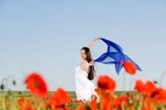 Attractive girl in the poppy field Stock Photos