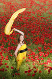 Attractive girl in the poppy field Stock Photo