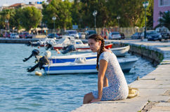 Attractive girl in port of Zakynthos town, Greece Stock Photo