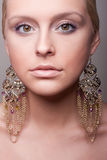 Attractive girl portrait with ethnic earring. Clean skin Stock Photo