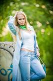 Attractive girl posing in jeans outdoor Stock Images