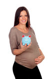 Attractive girl pregnant with a blue piggy-bank Stock Photo
