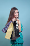 Attractive girl with purchases. Stock Photography