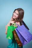 Attractive girl with purchases. Stock Image