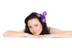 Attractive girl with purple flower Royalty Free Stock Images
