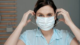 Free Attractive Girl Puts On Surgical Mask On Her Face. Cold, Flu, Virus, Acute Respiratory Infections, Quarantine, Epidemic, Irony, Royalty Free Stock Photo - 174268985