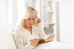 Attractive girl reading a book thoughtfully in the morning Royalty Free Stock Photography