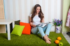 Attractive girl reading a journal royalty free stock image
