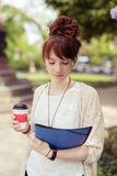 Attractive Girl Reading Something with Coffee Cup Royalty Free Stock Image