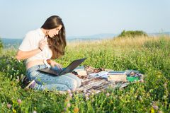 Attractive girl reading something on laptop Royalty Free Stock Image