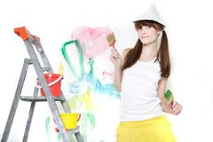 Attractive girl ready for painting over white Royalty Free Stock Photo