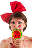 Attractive girl with a red bow and lollipop in mouth in lipstick kisses Stock Photography