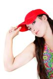Attractive girl in red cap Stock Photos