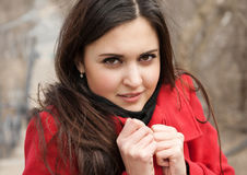 Attractive girl in red coat on plein air Stock Photo