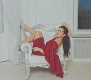 An attractive girl in a red dress. Stock Photos