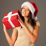 Attractive  girl in red dress and Santa Hat Stock Images