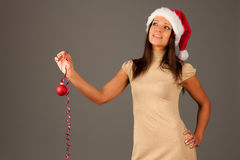 Attractive  girl in red dress and Santa Hat Royalty Free Stock Images