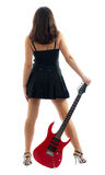 Attractive girl with red guitar. Attractive girl from back wearing miniskirt, holding red electric guitar, isolated on white background Stock Photos