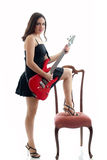 Attractive girl with red guitar Royalty Free Stock Photos