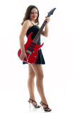 Attractive girl with red guitar dmiling Stock Image