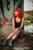 Attractive girl with red hair in the street Royalty Free Stock Photos
