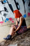 Attractive girl with red hair in the street Royalty Free Stock Image
