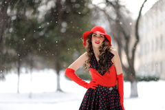 Attractive girl in red hat Royalty Free Stock Photos