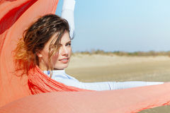 Attractive Girl With Red Scarf on The wind Stock Image