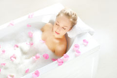 Attractive girl relaxing in bath Royalty Free Stock Photos